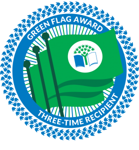"""Three green flags bearing the Eco-Schools USA logo, and the text around it, white on a blue halo of animal tracks, """"Green Flag Award, Three-Time Recipient."""""""